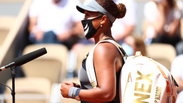 Naomi Osaka talks to a courtside interviewer after her first-round win at the French Open.
