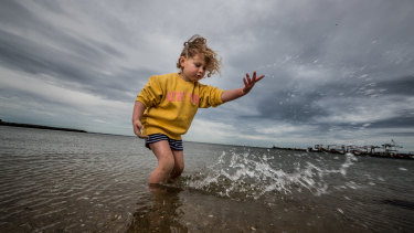 Flora Weiss, 4, enjoys the water in Port Melbourne on the last day of winter.