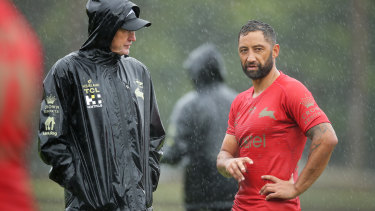Benji Marshall and Wayne Bennett stop for one of their many chats at a soggy Redfrern this week.