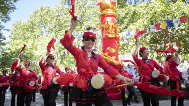Members of the Federation of Chinese Community of Canberra Inc. perform on day one of the multicultural festival in Civic.