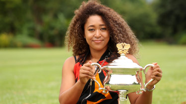 Naomi Osaka poses with the Daphne Akhurst Memorial Trophy after winning the 2021 Australian Open.