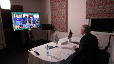 Prime Minister Scott Morrison taking part in the 2020 virtual G20 summit from The Lodge.