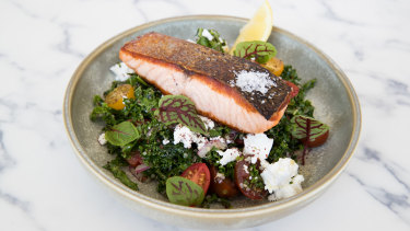 """Z.I.A Kitchen's crisp-skinned salmon fillet with """"kabbouli"""" salad, where kale leaves stand in for parsley."""