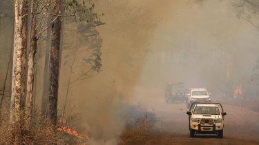 Firefighters battle bushfires in Busbys Flat, northern NSW, Wednesday.