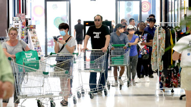 People queuing at Woolworths at West Torrens in Adelaide on Wednesday.