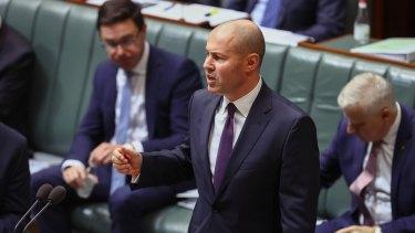 Treasurer Josh Frydenberg's budget assumes the Australian border won't be reopened until the middle of 2022.