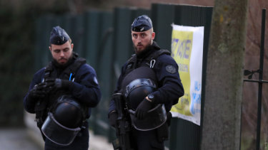 Riot police officers look on after a man attacked passerby on Friday January 3, 2020 in Villejuif, south of Paris.
