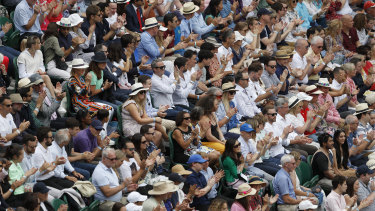 A full capacity crowd watches the men's singles final between Serbia's Novak Djokovic and Italy's Matteo Berrettini at Wimbledon.