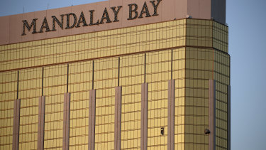 Curtains billow out of broken windows at the Mandalay Bay hotel room occupied by the shooter on the Las Vegas Strip.