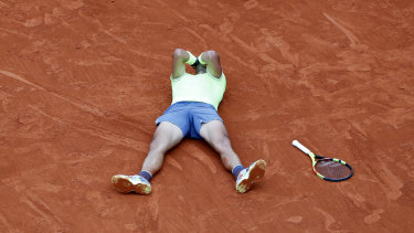Rafael Nadal collapses onto the court after winning the French Open on Sunday.