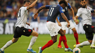 France's Kingsley Coman scores the opening goal during the Euro 2020 group H qualifying match between France and Albania at the Stade de France.