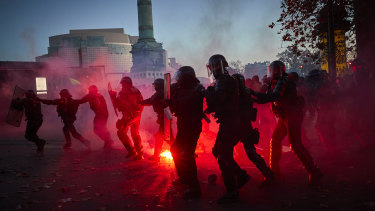 French Riot police clash with protestors as demonstrations against the French Government's Global Security Law turn violent near Place de la Bastille in Paris.