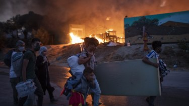 Migrants flee from the Moria refugee camp during a second fire, on the north-eastern Aegean island of Lesbos, Greece.