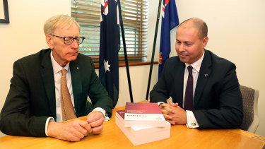 "There wasn't a lot of conversation when banking royal commissioner Kenneth Hayne (left) delivered his final report to Treasurer Josh Frydenberg. ""A handshake or something ...?"" implored a photographer."