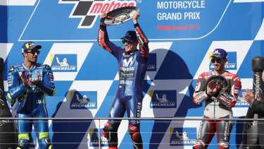 Trophy moment: Spain's Maverick Vinales (centre) celebrates after winning the Australian Motorcycle Grand Prix 2018 while (left) Italy's Andrea Iannone of Team Suzuki Ecstar in second and (right) Italy's Andrea Dovizioso of Team Ducati watch on.