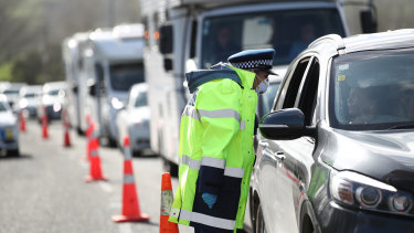 Here we go again: Queues stretch for kilometres in and out of Auckland as police stop vehicles at a checkpoint.