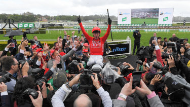 Jockey Kerrin McEvoy celebrates his second Everest success last year on Redzel in front of a packed Randwick.