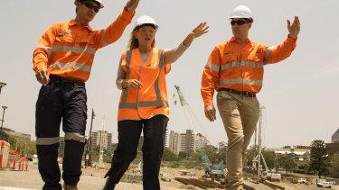Kate Jones (centre) took over as Cross River Rail Minister last year.