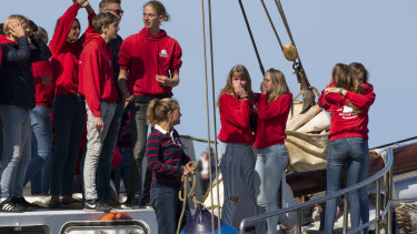 Teens wave, cry and hug as their schooner, carrying 25 Dutch teens who sailed home from the Caribbean across the Atlantic when coronavirus lockdowns prevented them flying, arrived at the port of Harlingen, Netherlands.
