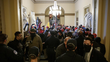 Members of the US Capitol Police trying to block demonstrators from reaching the House Floor.