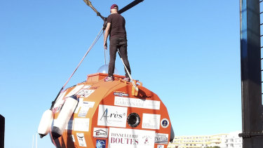 Jean-Jacques Savin, 71, stands on top of his ocean-going barrel.