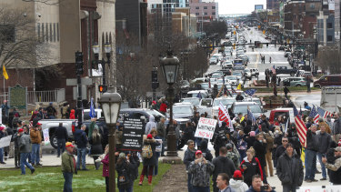 Sick and tired: protesters gather at the Michigan State Capitol in Lansing, Michigan.