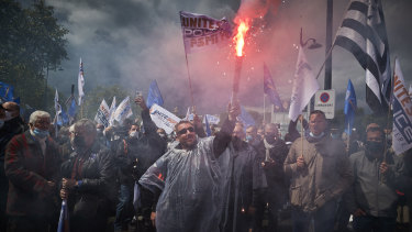 Raw emotions: Police officers demonstrate outside the French Parliament.
