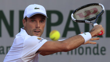 Spain's Roberto Bautista Agut plays a shot against Spain's Pablo Carreno Busta in the third round match of the 2020 French Open.