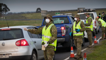 Soldiers assist police at a checkpoint near Geelong.
