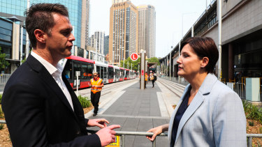 Labor leader Jodi McKay and the party's now transport spokesman Chris Minns speak in December.
