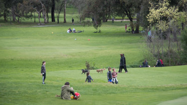 Locals using Northcote golf course as a park.