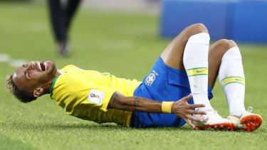 Oscar worthy: Brazil's Neymar grimaces in pain after a tackle.