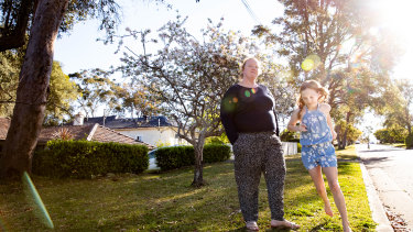 Kate Walther and her daughter, Lucy, 10, who will not return to school this year because of a chronic health condition.