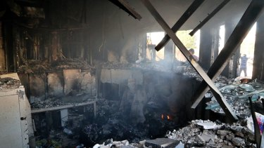 Smoke rises from the reception room of the US embassy that was burned by Pro-Iranian militiamen.
