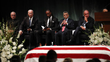 Father Edward Reese, from left, former vice-president Joe Biden, Larry Fitzgerald, Tommy Espinoza, and Grant Woods wait to speak during memorial service at North Phoenix Baptist Church for Senator John McCain on Thursday in Phoenix.