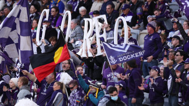 Purple patch: Fremantle fans show their colour in Sunday's derby.