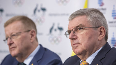 AOC president John Coates (left) and IOC president Thomas Bach. The pair will meet next week in Switzerland to discuss the prospect of a 2032 Games in Queensland.