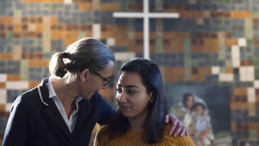 Hayarpi Tamrazyan, a 21-year-old Armenian asylum seeker, right, gets a hug from spokesperson Florine Kuethe inside the Bethel chapel in The Hague last month.