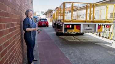 A truck backs up along an easement adjoining Karen Paxton's small business in Fyshwick. The valuation on her block went up 300 per cent in 2016-17, affecting her business.