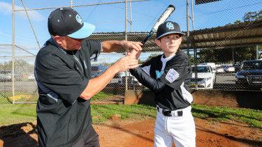 Head coach Jason Choat with son Ewan.