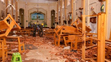 Sri Lankan soldiers inspect the damage inside St. Sebastian's Church where a bomb blast took place in Negombo, Sri Lanka.