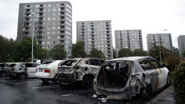 Burned cars parked at Frolunda Square in Gothenburg.
