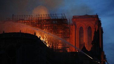 Firefighters use hoses as Notre-Dame Cathedral burns in Paris.