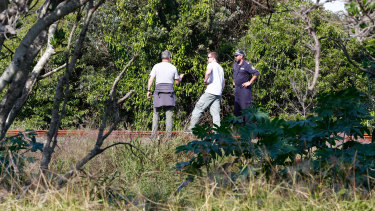 Police, undercover police and sniffer dogs search for missing backpacker Theo Hayez, along the northern railway line, his last known location in Byron Bay.