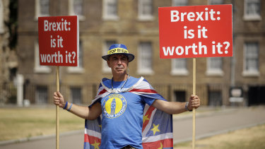 Anti-Brexit, pro-EU supporter Steve Bray holds placards across the road from the Houses of Parliament in London, on Monday.