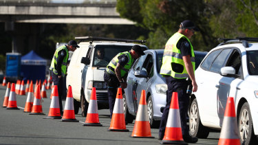 Police stop vehicles at the Queensland-NSW border in Coolangatta on October 1.