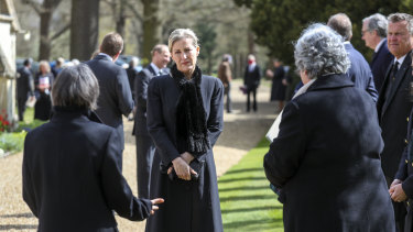 Sophie, Countess of Wessex talks to household staff and mourners at a small church service at Windsor.