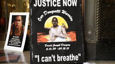 "Banners reading ""Justice for David Dungay"" outside the Downing Centre Court in Sydney. He died in custody in 2015."