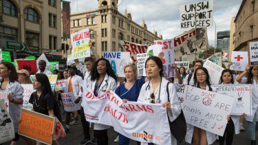 Health professionals were among the thousands that took part in the Palm Sunday rally in Sydney.