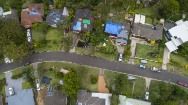 Many homes in Berowra Heights had their roofs covered in tarpaulins on Friday.